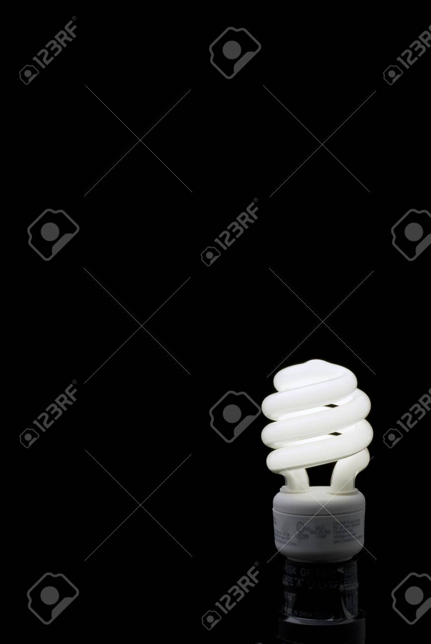 Compact Fluorescent bulb against a black backround with plenty of space for type. Stock Photo - 2482841