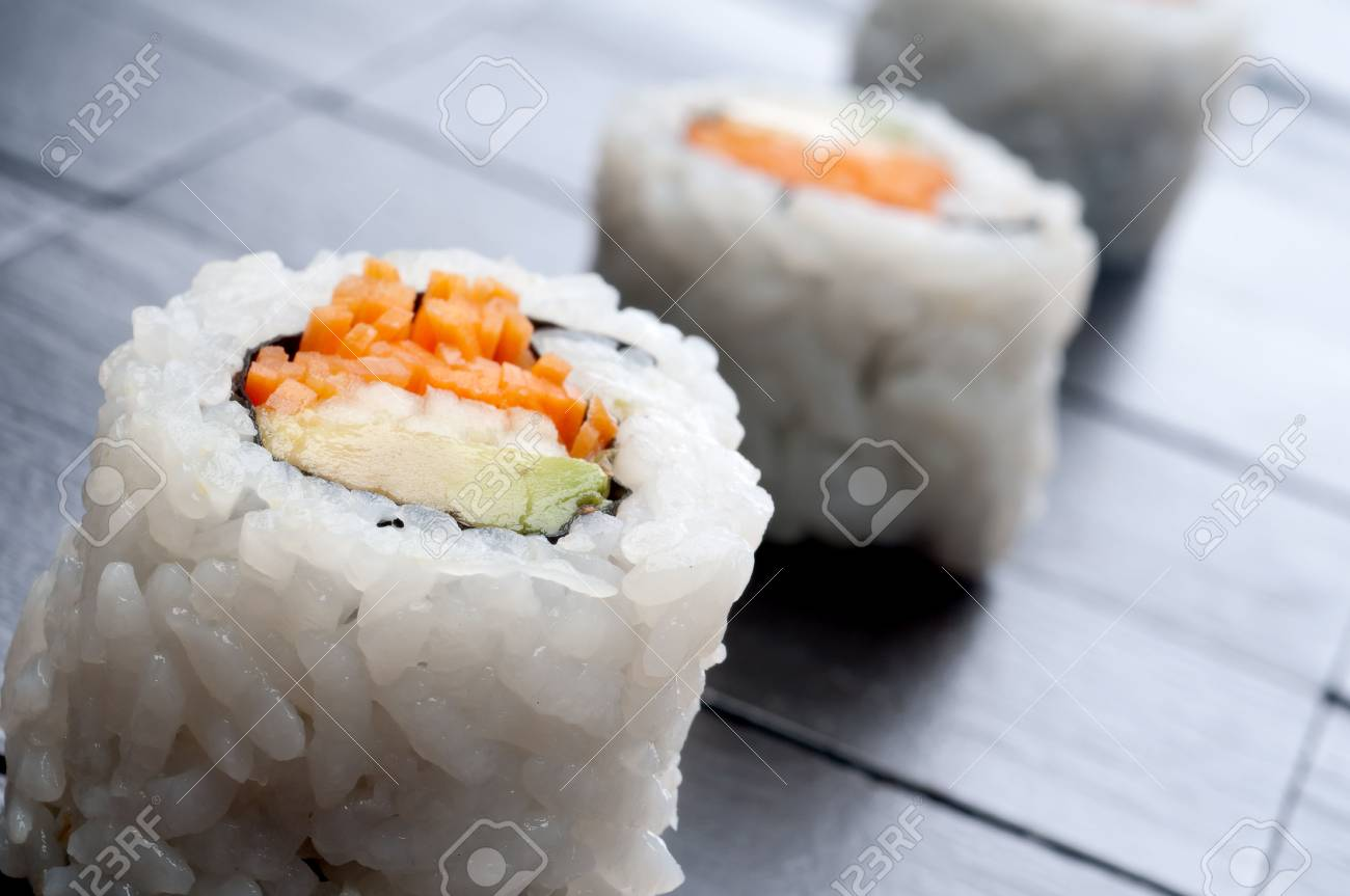 a tilted shallow focus horizontal macro of 3 rolls of sushi Stock Photo - 5064332