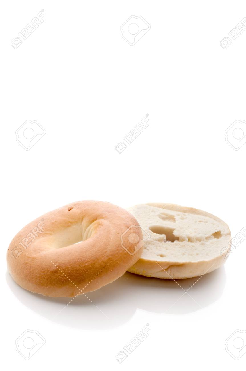 A sliced bagel on a white reflective background Stock Photo - 5594712