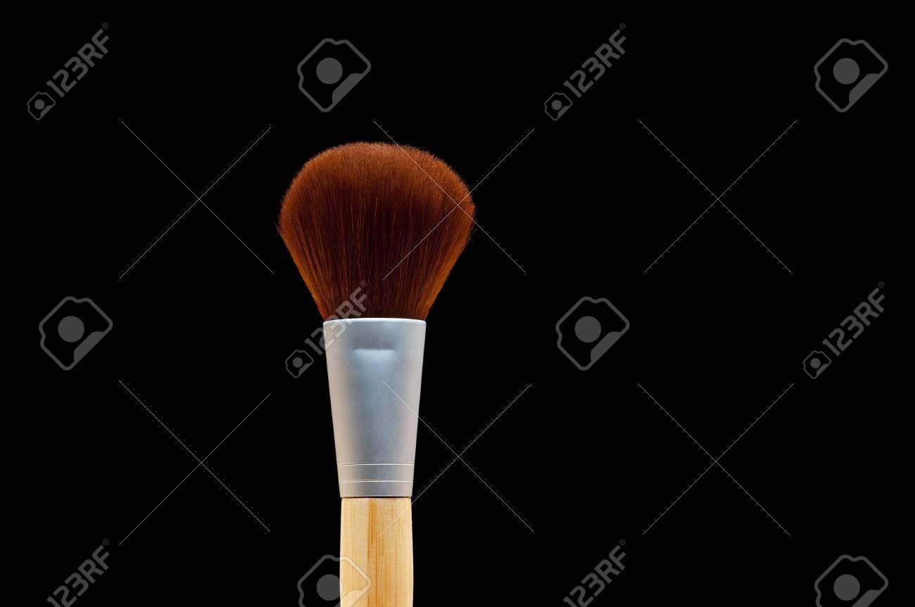 Horizontal close up of a make-up brush on black Stock Photo - 6387492
