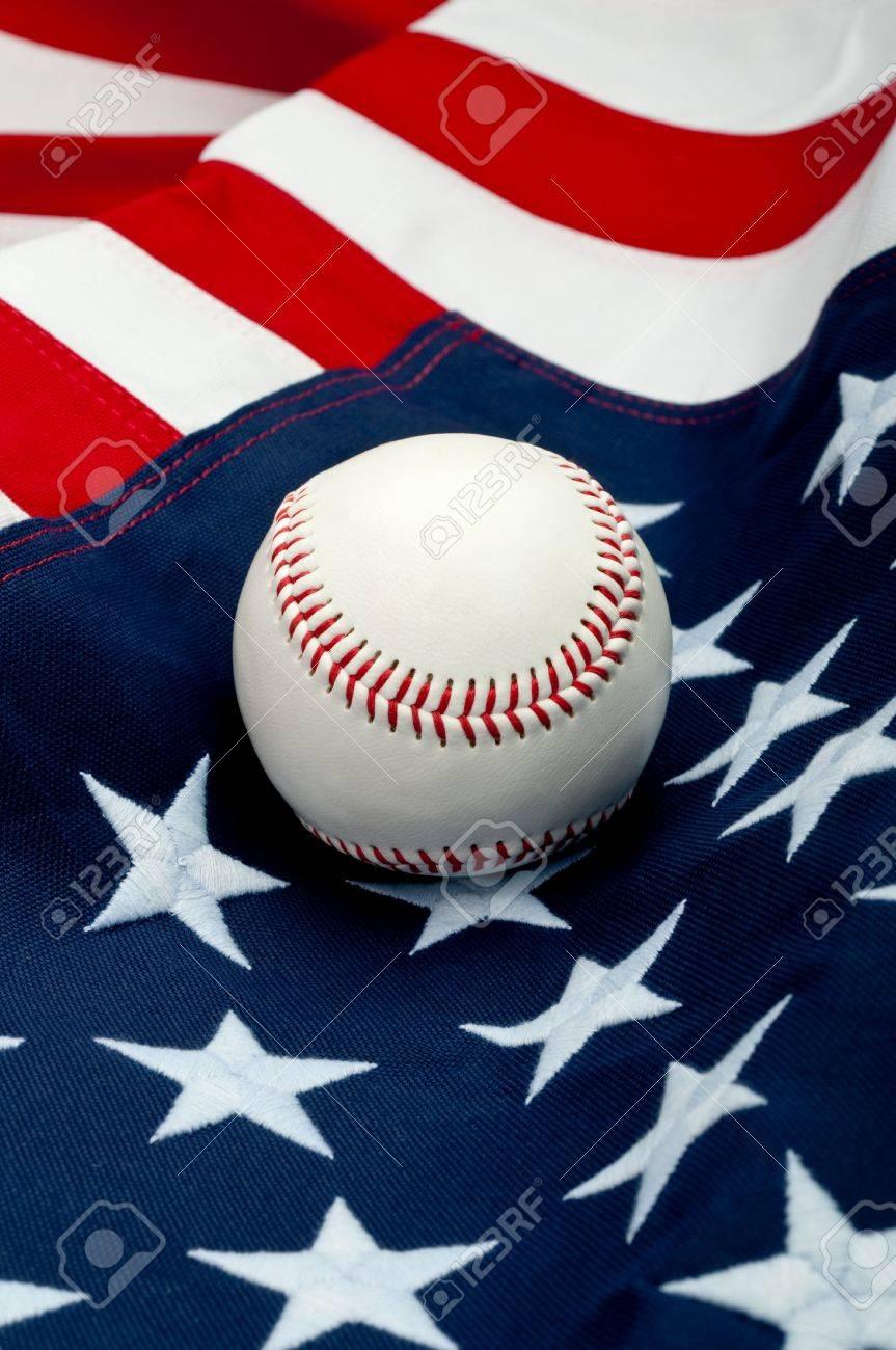 A white baseball on the American flag Stock Photo - 6622545