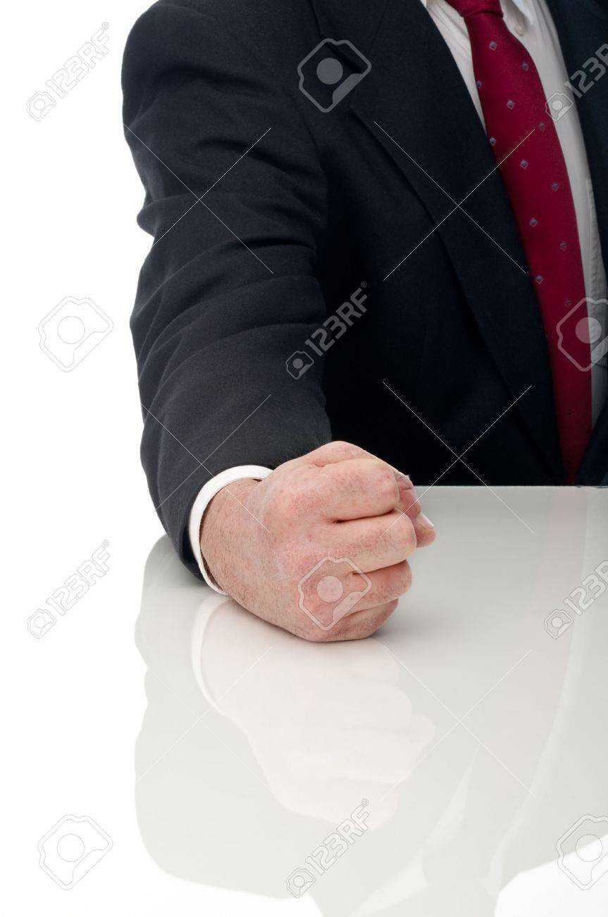 Vertical image of an angry business man banging fist on table Stock Photo - 6622547