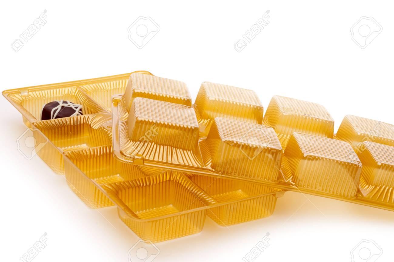 Horizontal image of the single last chocolate on white with trays Stock Photo - 6622591