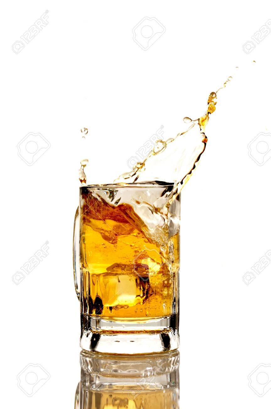 Beer splashing on a white reflective background Stock Photo - 6722338
