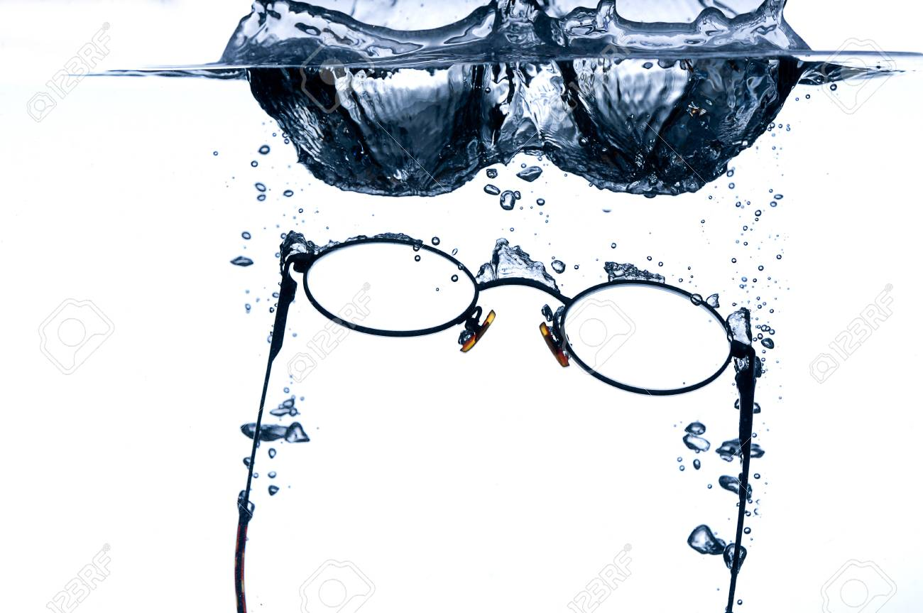 Eyeglass splashing in to water with a hint of blue Stock Photo - 6900897