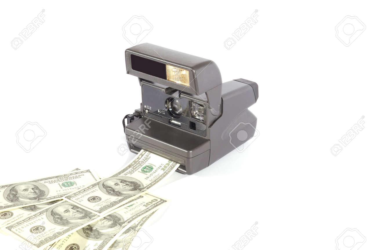 Old instant film camera making money