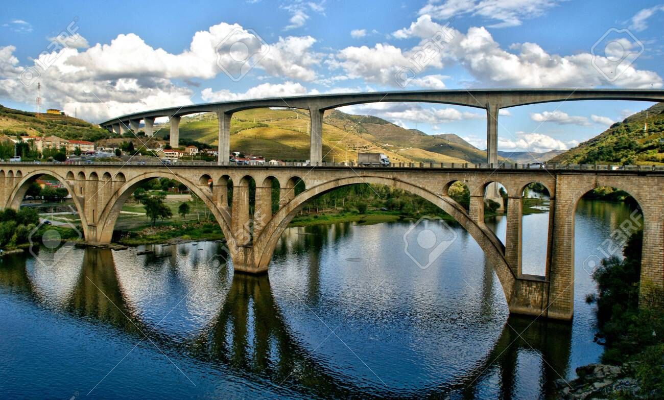 Bridges over the Douro River in the city of Regua in Portugal - 144771672