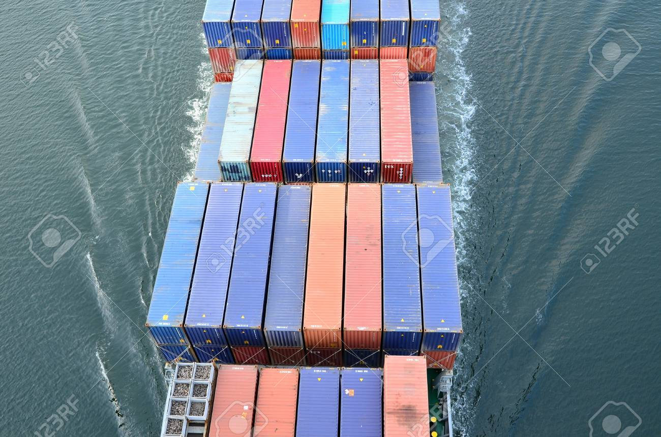 VARNA, BULGARIA - JANUARY 20: Cargo ship DS BLUE OCEAN (Flag: United Kingdom, IMO: 9341976) sails into open sea on January 20, 2011 in Varna, Bulgaria. Ship`s next destination is Island of Malta. Containers on board the ship seen from above.  Stock Photo - 8706910