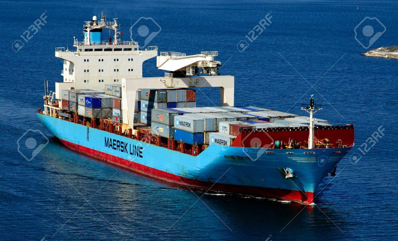 VARNA, BULGARIA-MAR 24: Cargo ship MAERSK TRAPANI (Year Built: 1990, Dead Weight: 21238 t) sails away into open sea after a short stay in Varna-west port on March 24, 2011 in Varna, Bulgaria Stock Photo - 9158021