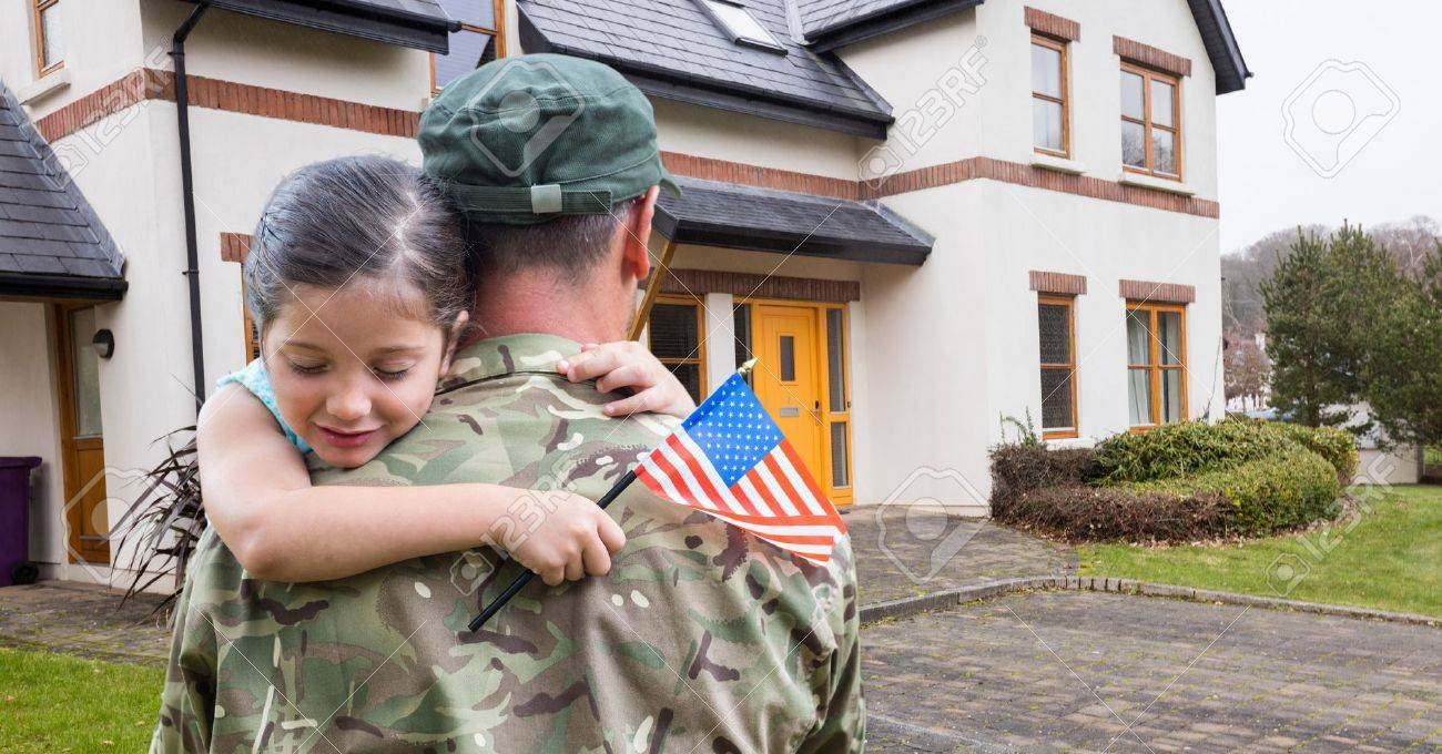 Composite images of American soldier carrying girl in front of a house Stock Photo - 71082107