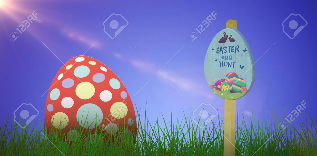 easter egg hunt sign against grass against white background stock photo 75585368