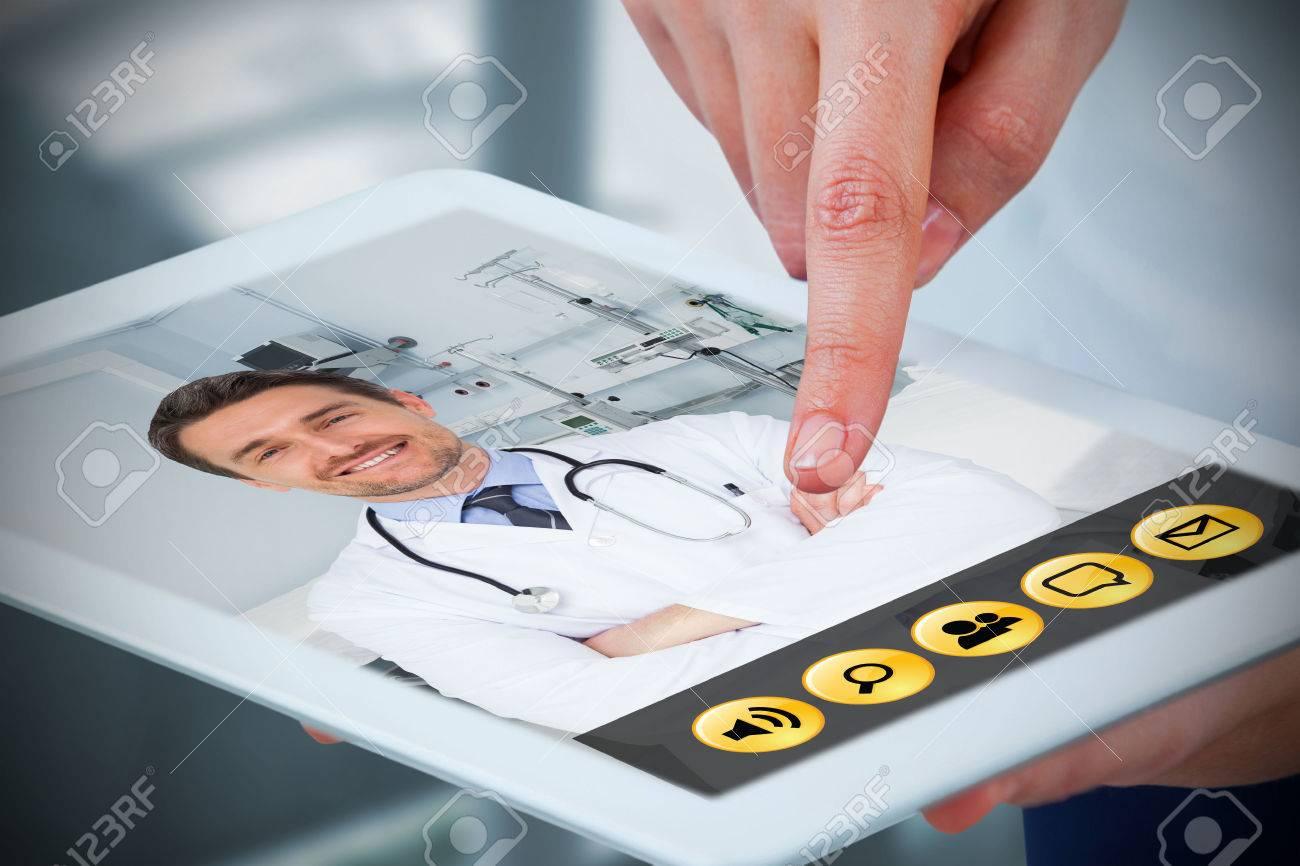 Hands using digital tablet against white background against sterile bedroom Stock Photo - 78600267