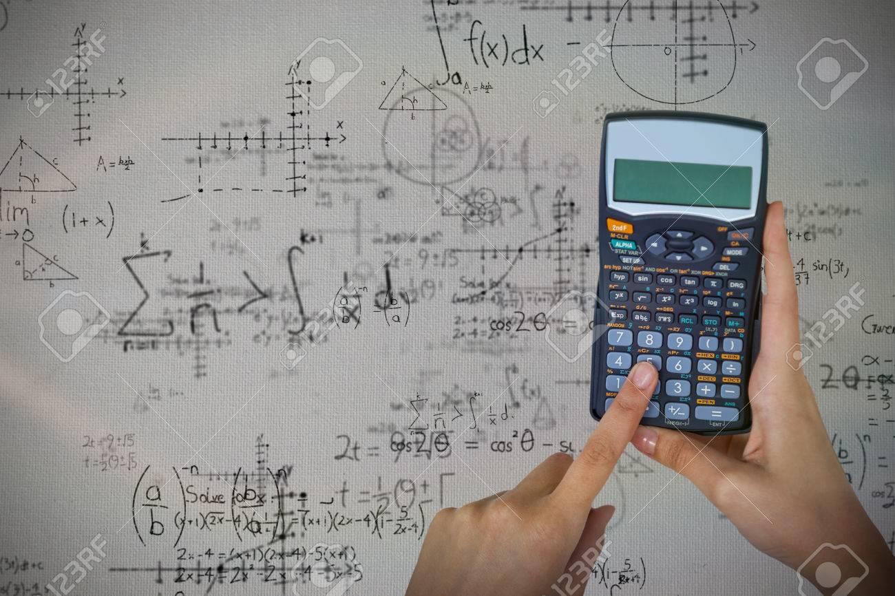 Hands Of Businesswoman Using Calculator Against Quadratic Equations