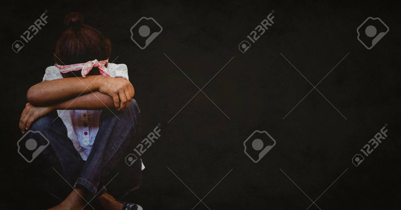 Digital composite of Girl with head between knees against black background with grunge overlay Stock Photo - 79254194