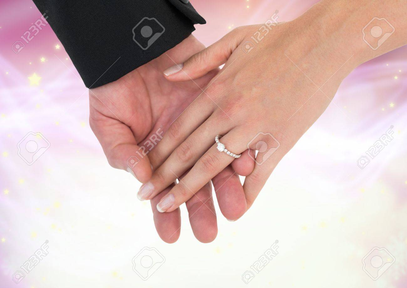 Digital Composite Of Hands Holding Together Wedding Engagement ...