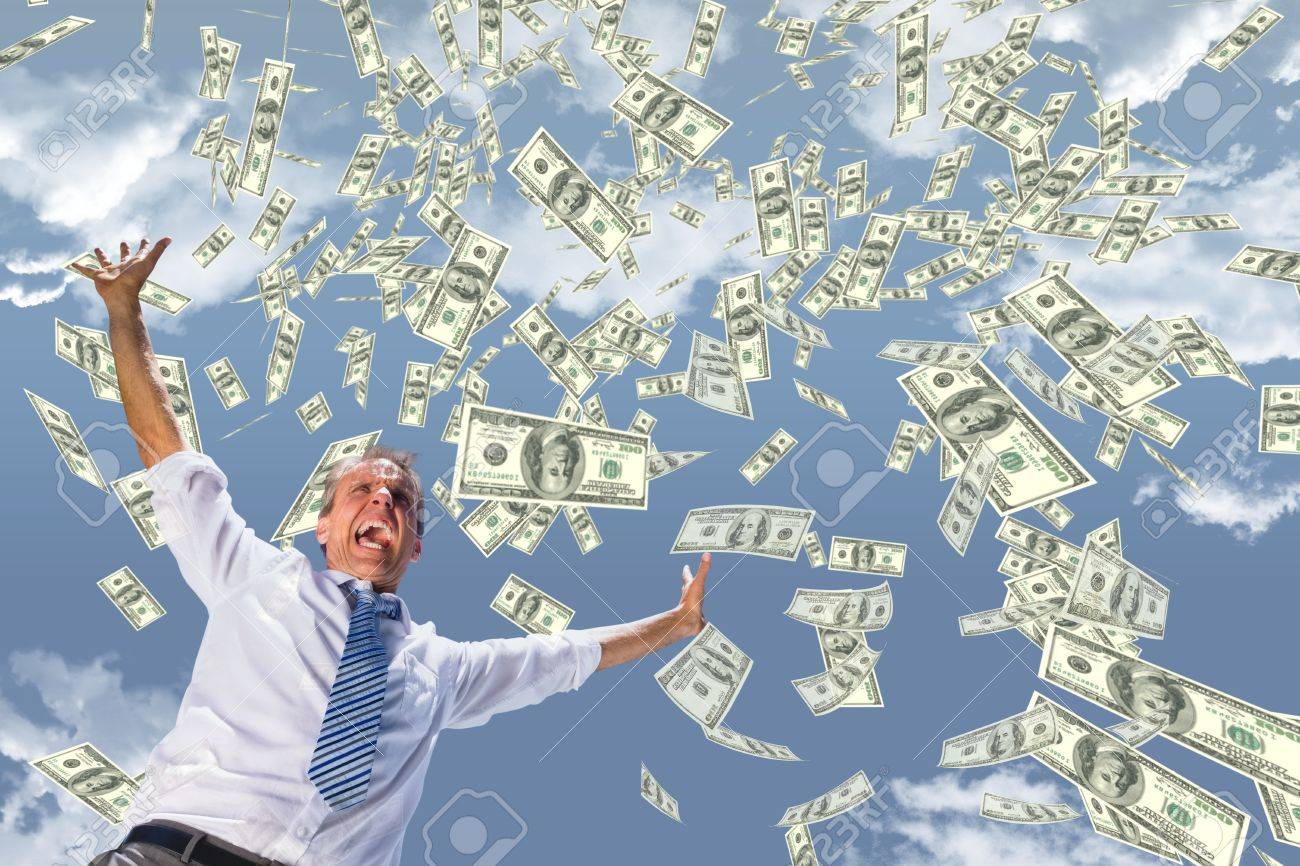 Digital composite of Excited business man with money rain against sky - 82481010