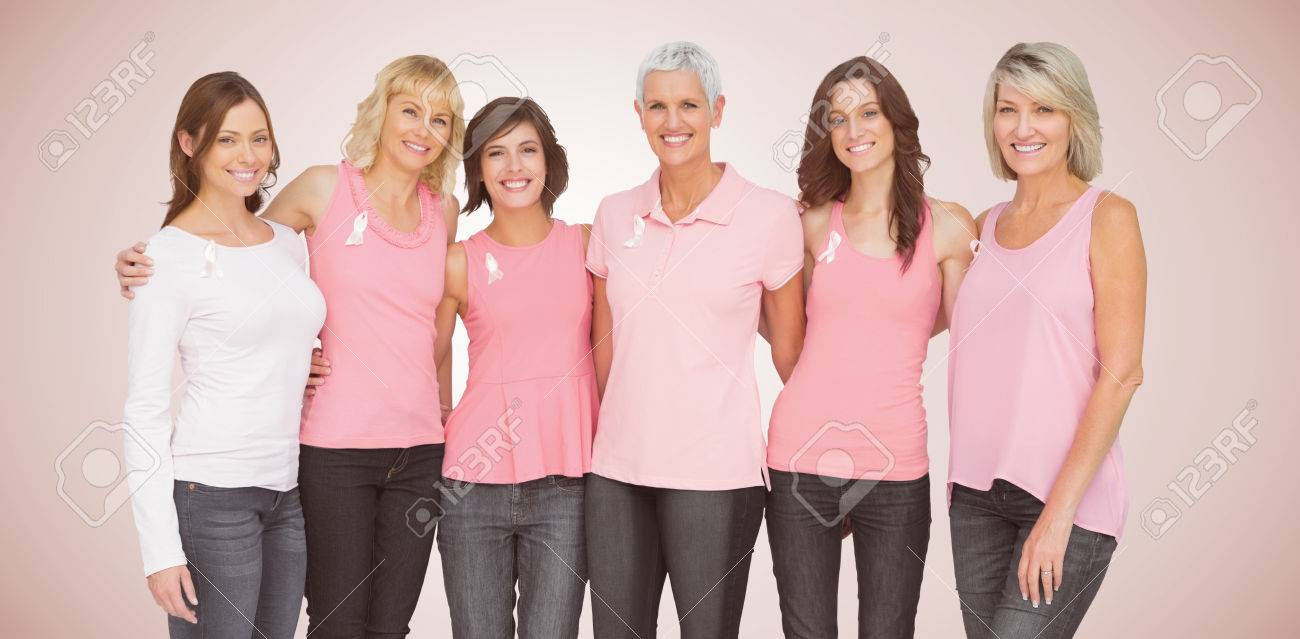 Portrait of smiling women supporting cancer social issue against neutral background - 85783091