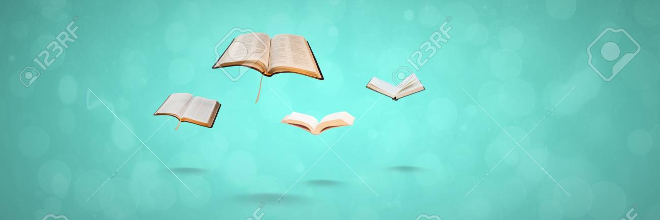 Digital composite of Flying books on blue background Stock Photo - 94980671