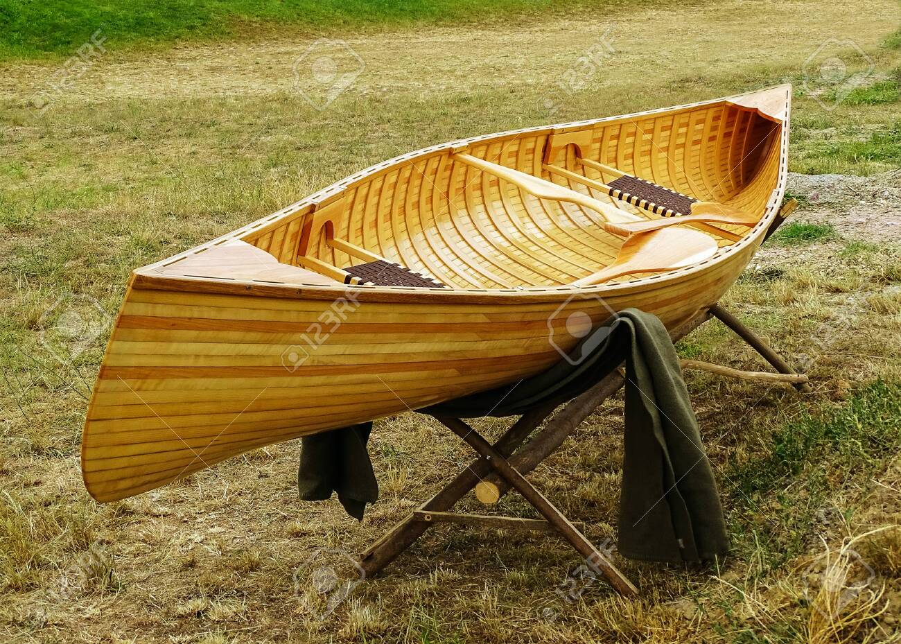 Enjoyable Wooden Boat Placed On A Wooden Stand In The Meadow After The Evergreenethics Interior Chair Design Evergreenethicsorg