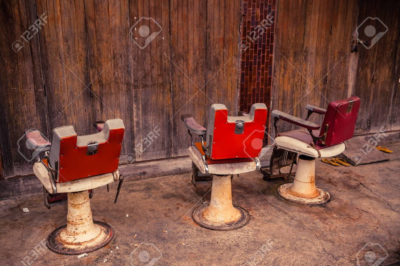 Old Barber Chairs >> Group Of Old Barber Chairs On Wooden Background