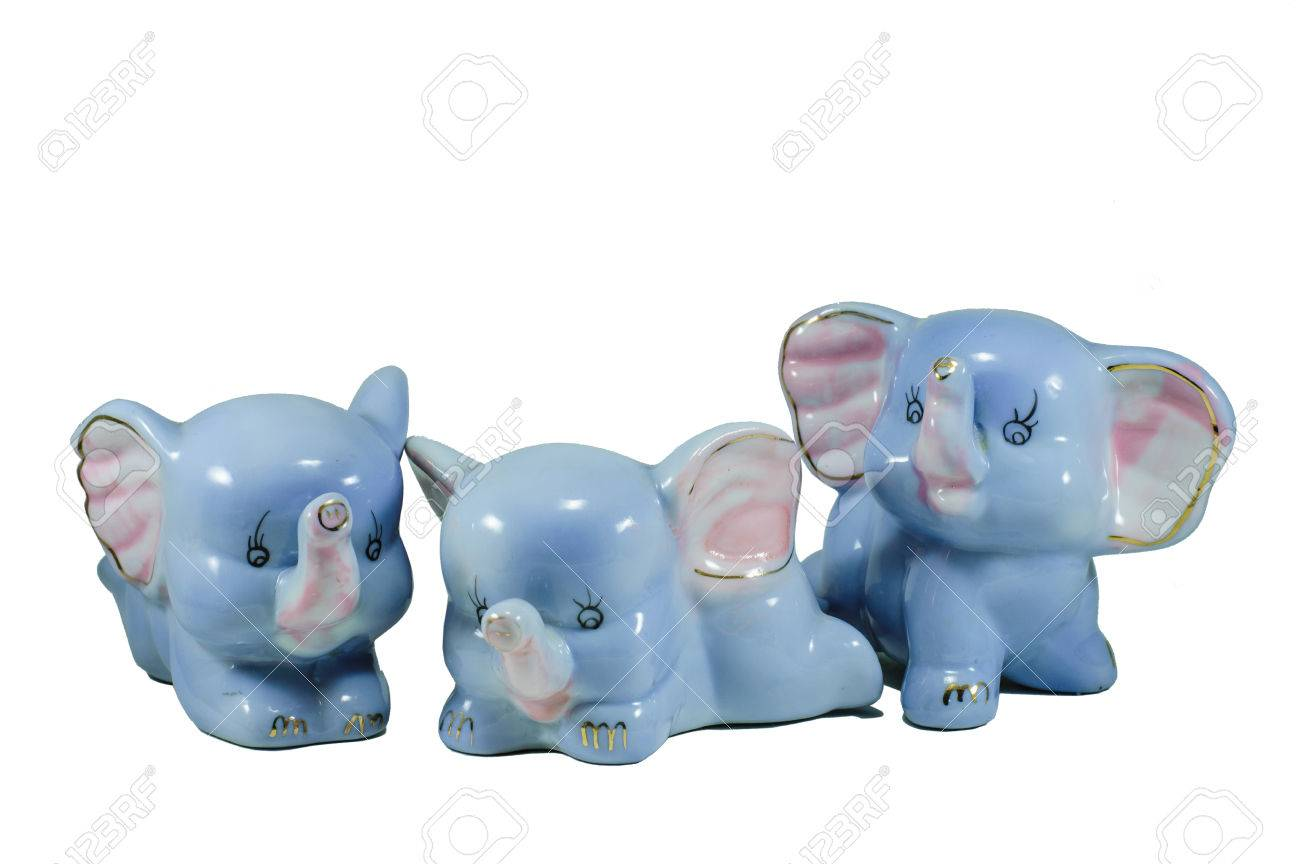 Isolated three blue porcelain elephants in different positions
