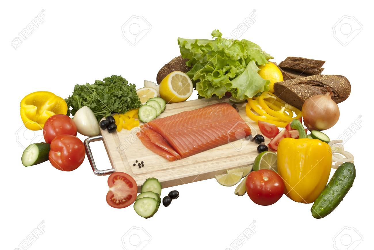 red fish surrounded by vegetables. tomatoes, cucumbers, onions, peppers, parsley, lemon, salad, bread, lemon, olives Stock Photo - 16500621