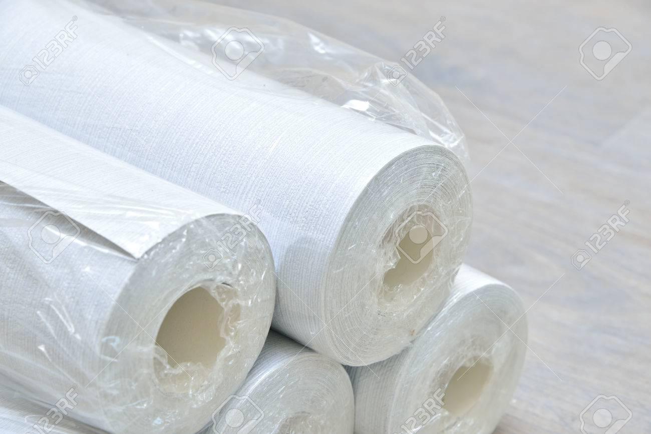 many gray wallpaper rolls on floor - 37753755