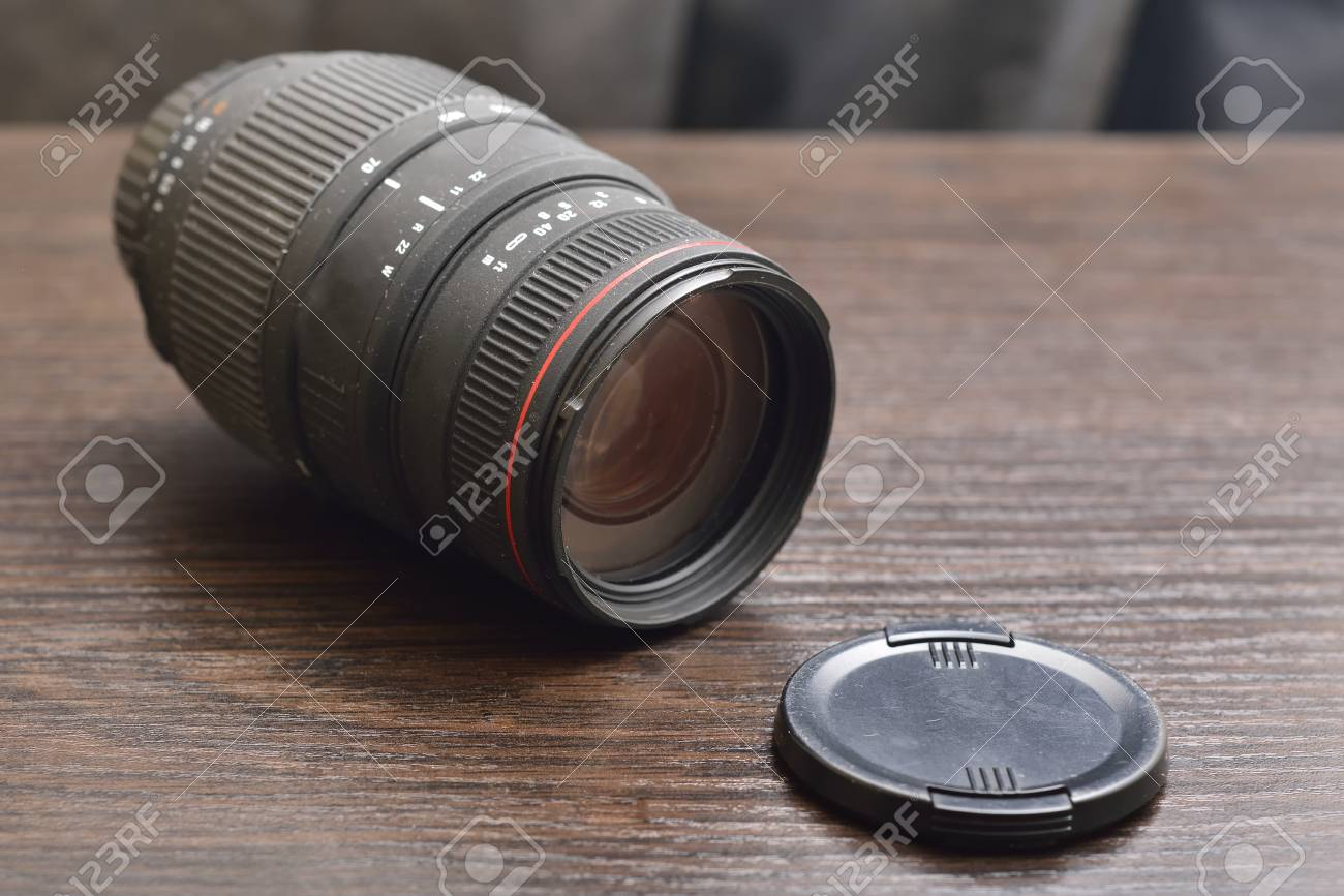 camera lens on wooden background - 55028572
