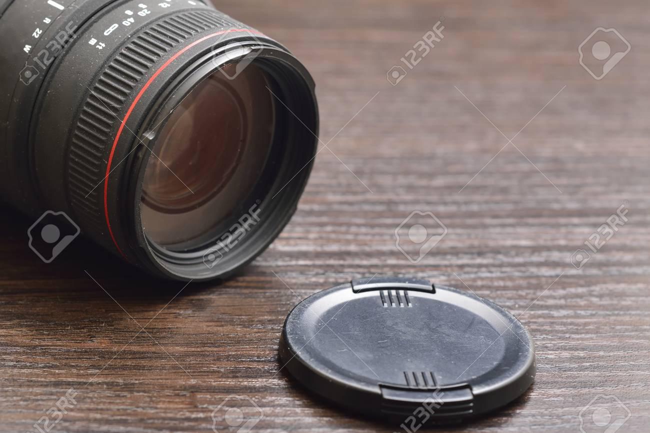 camera lens on wooden background - 55028615