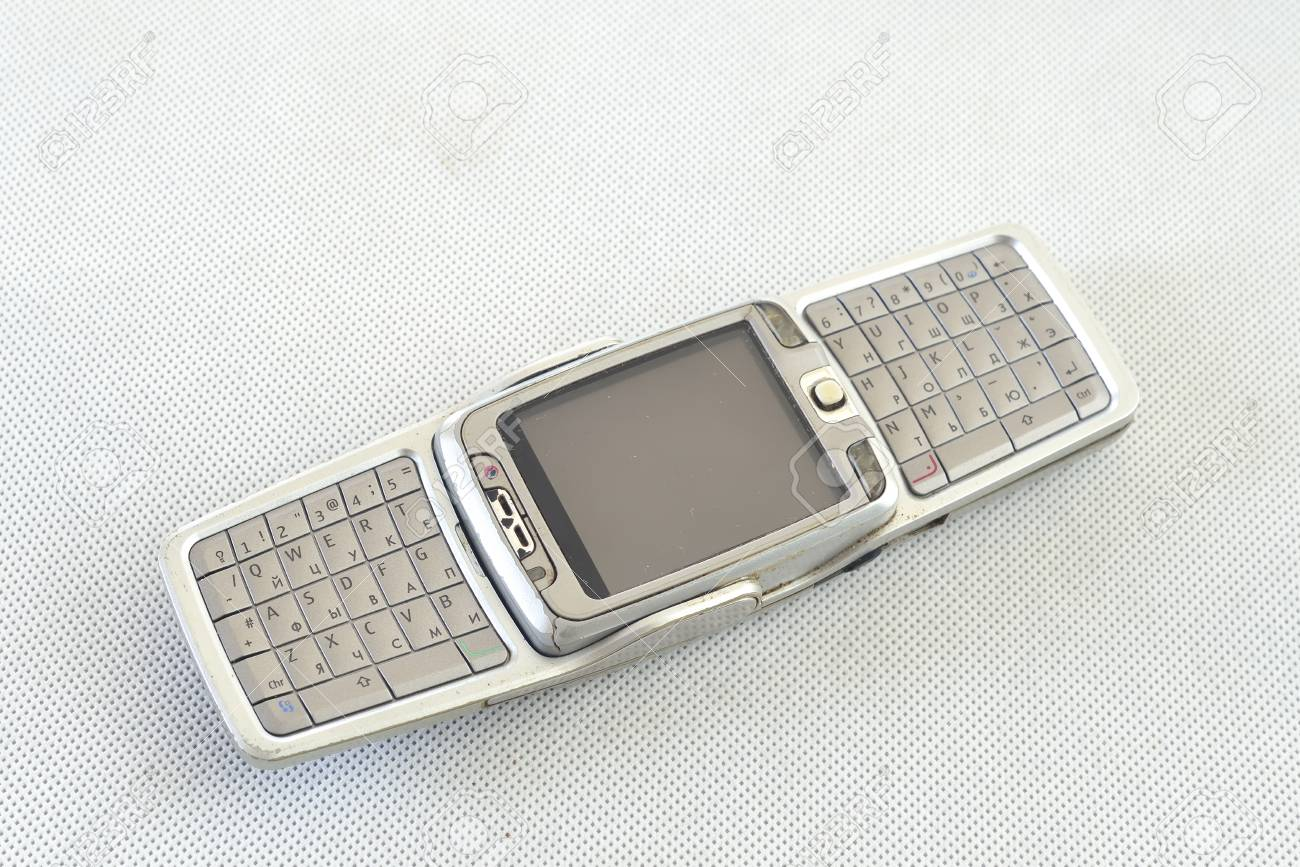 a5d65fc44ae Recycling old cell mobile phones with keyboard over white Stock Photo -  55029892