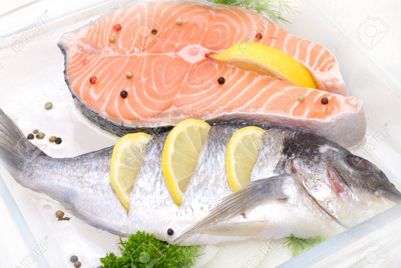 big salmon fish defrosting before cooking - 58948877