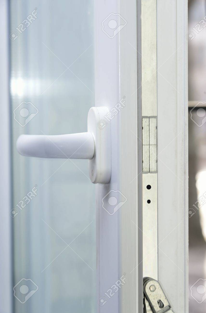 white metal-plastic window with handle and glass - 59481298