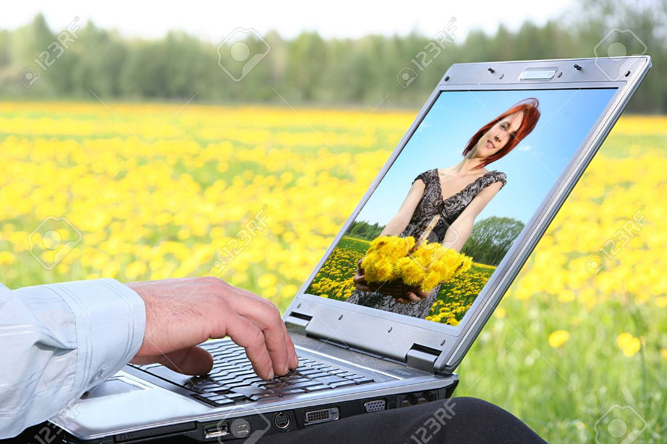 laptop with picture of beautiful girl on desctop Stock Photo - 4022731