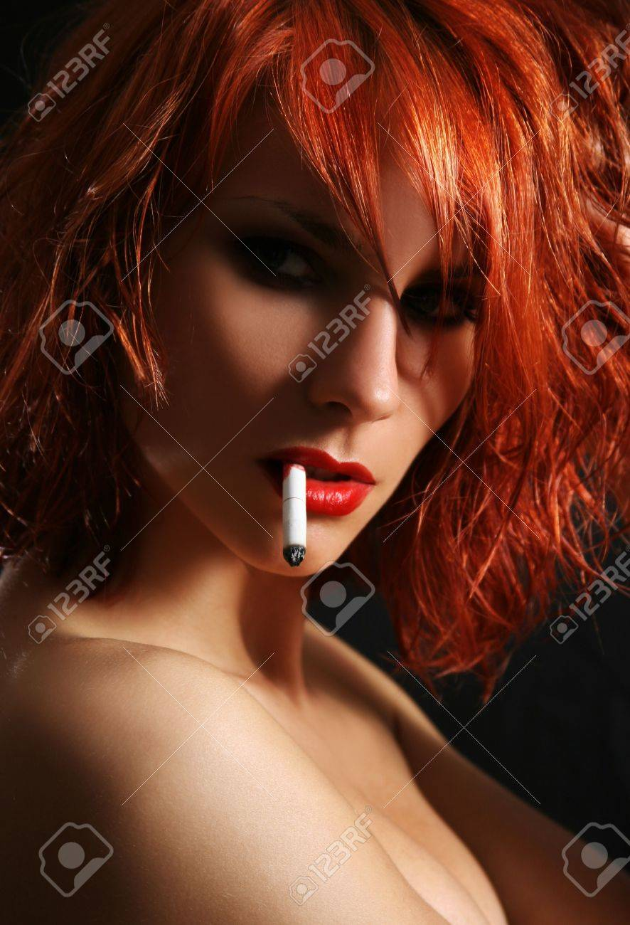 sexy young woman snoking cigarette Stock Photo - 5036646