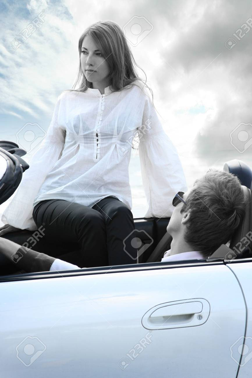 modern young couple in white car Stock Photo - 5306256