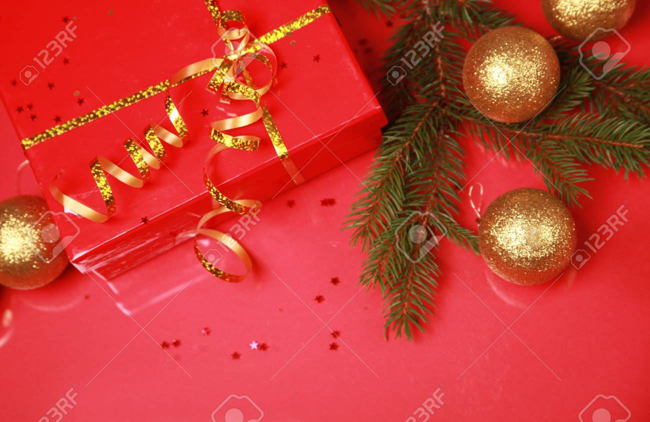 christmas background with golden balls and present Stock Photo - 5852343
