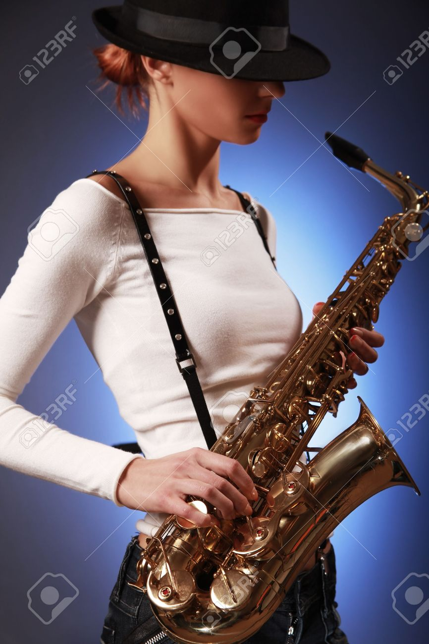 sexy young woman with saxophone (sax in focus) Stock Photo - 5836411