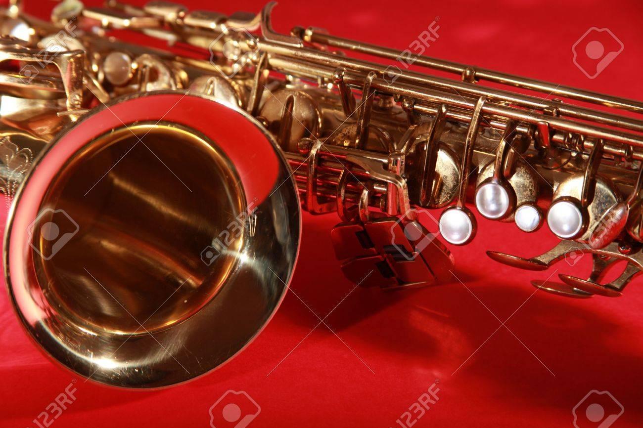 golden shiny saxophone on red background Stock Photo - 5937190