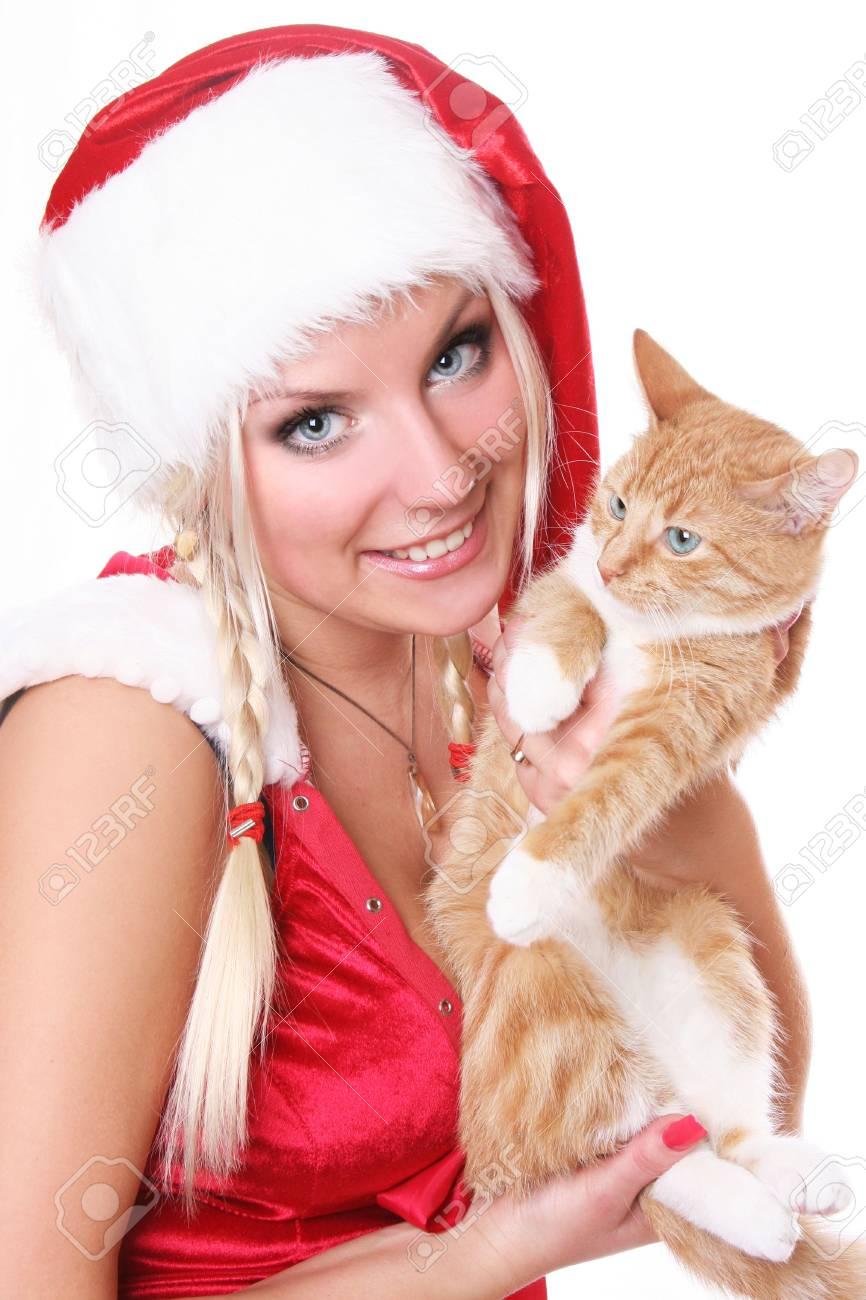 blue-eyed santa girl with fluffy kitten Stock Photo - 5933558