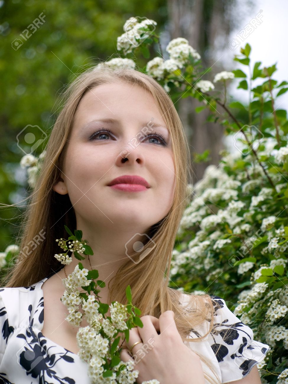 Portrait of beautiful woman with flower at hand on natures portrait of beautiful woman with flower at hand on natures background stock photo 3170281 dhlflorist Gallery