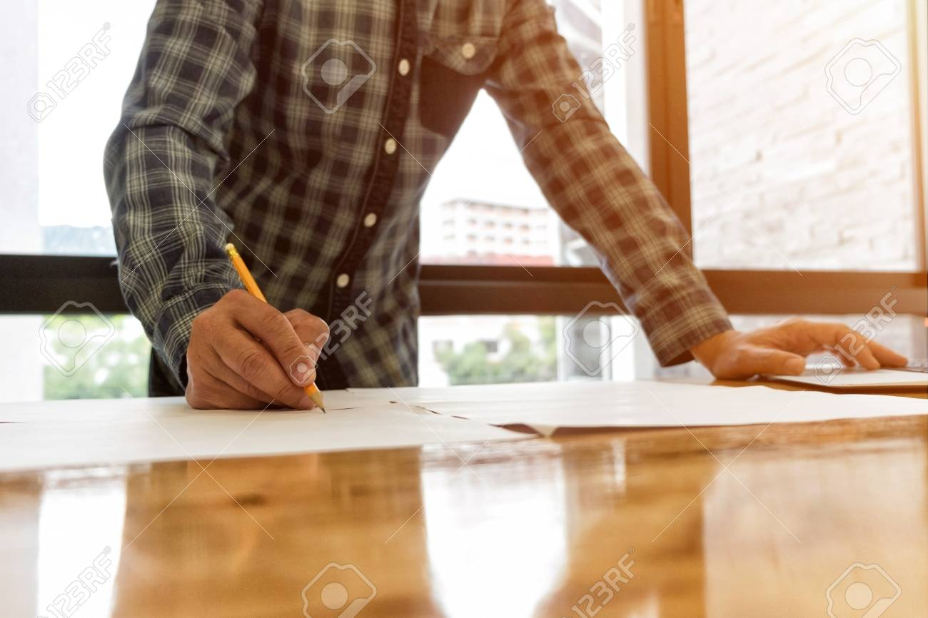Architecte projet architectural dessin sur plan concept d