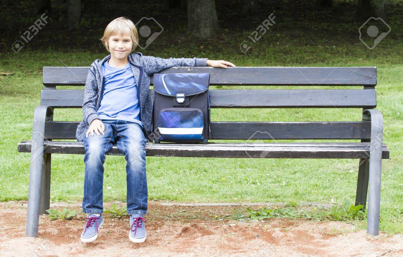 Marvelous Smiling Boy Sitting On A Wooden Bench With His Backpack Education Bralicious Painted Fabric Chair Ideas Braliciousco