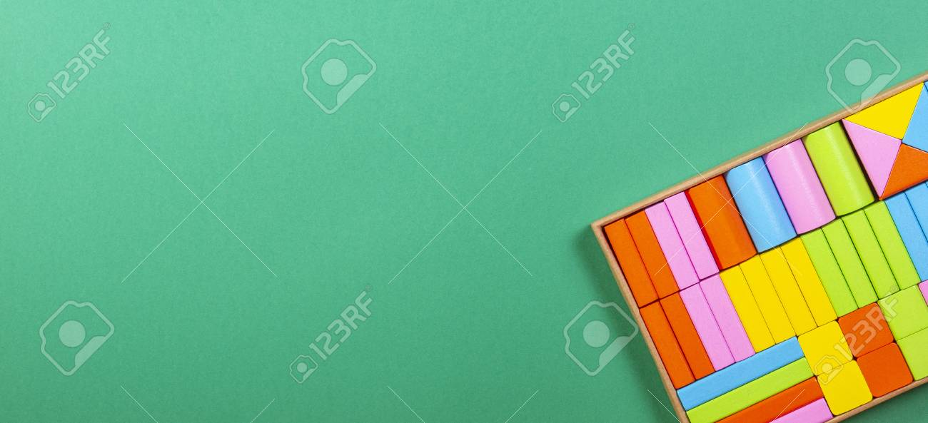 colorful wooden blocks in the box on green background ロイヤリティー