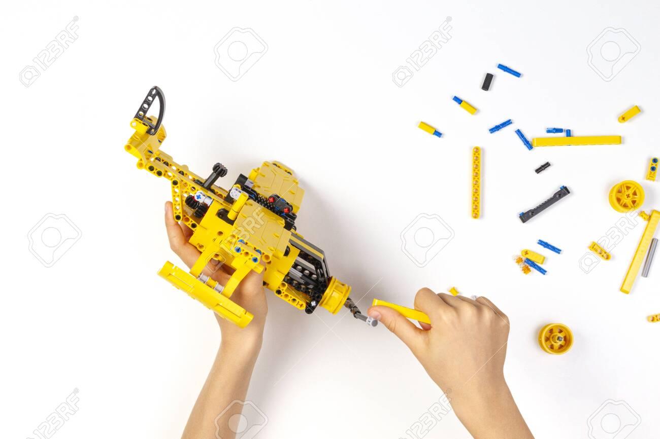 Child hands making construction plane. Robotic, learning, technology, stem education for children background - 133483869