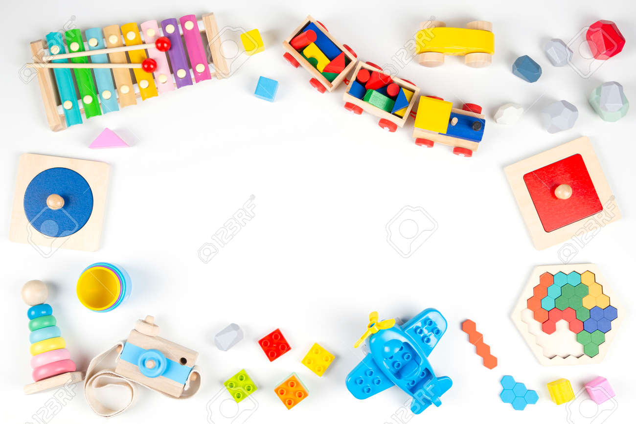 Colorful educational and musical toys for baby kids on white background. Top view, flat lay frame - 166212218
