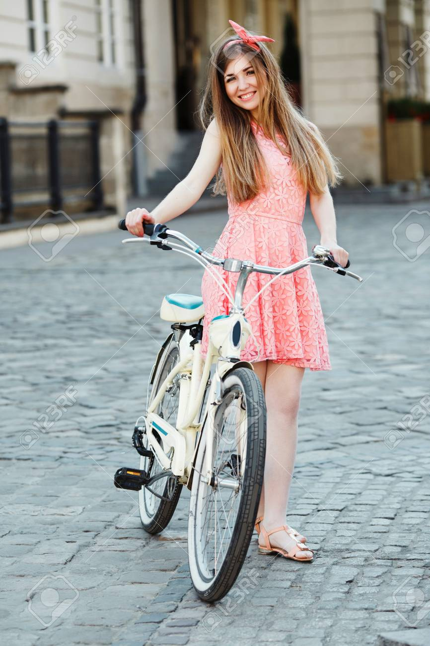 girl with bicycle - 122488759