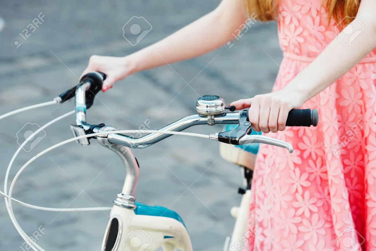 hands of a girl on bicycle handlebar - 122488768
