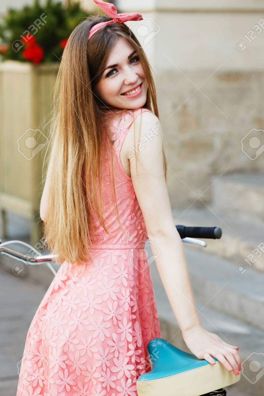 girl smiling and looking at camera - 122488770