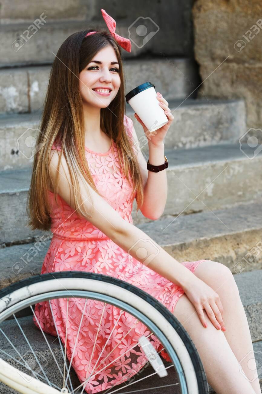 Young girl sitting and looking at camera - 122488774