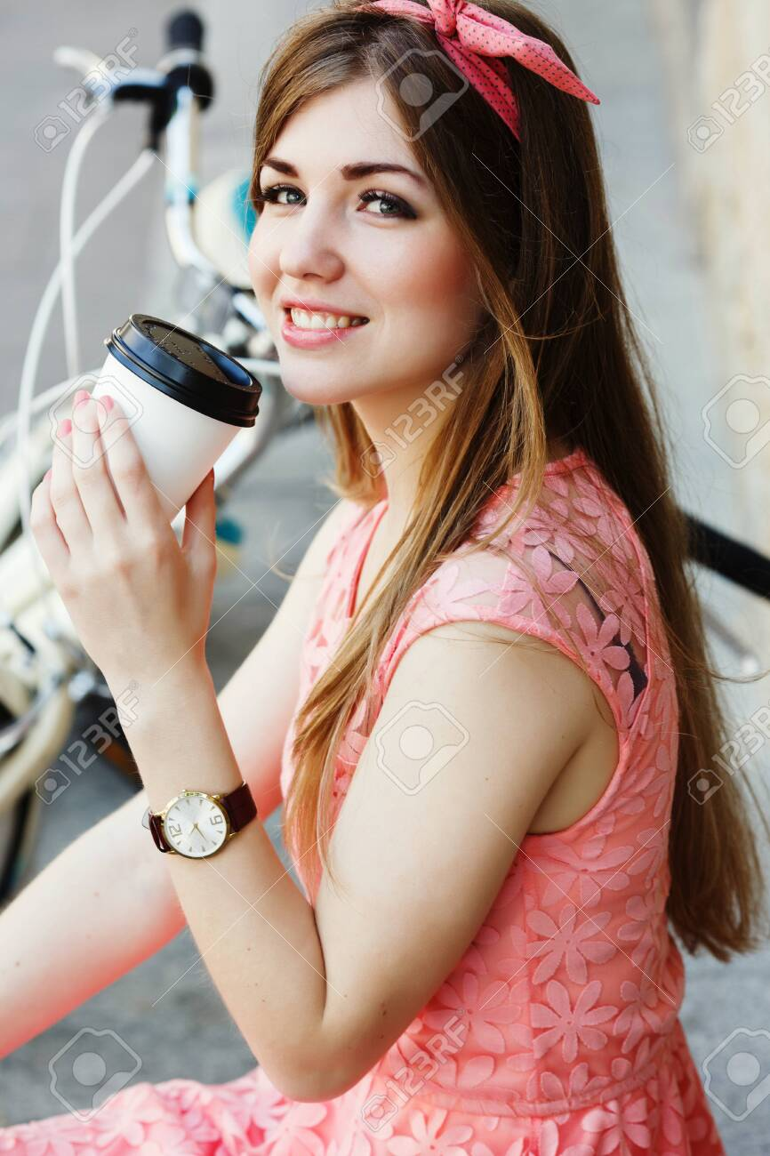 girl smiling with a cup of coffee, close-up - 122488777